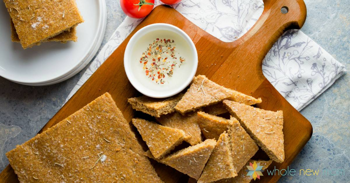 This Focaccia Flax Bread Recipe whips up super fast and tastes great with both sweet and savory fillings. Plus it's grain-free too and freezes great! Perfect for dipping or sandwiches!