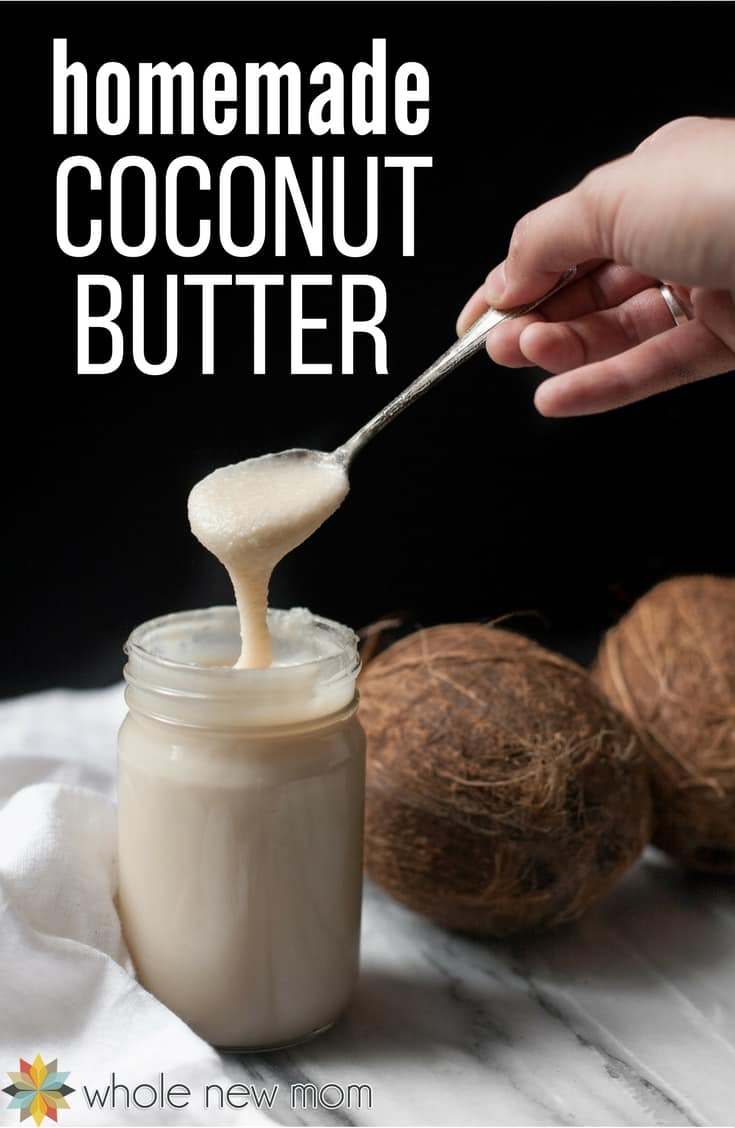 Hand getting Homemade Coconut Butter out of a jar